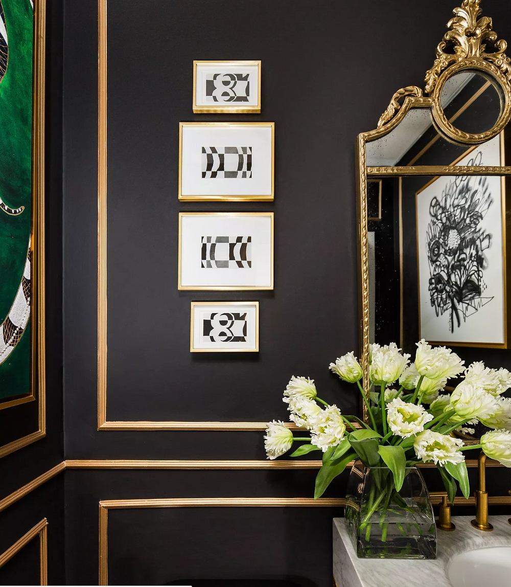 Powder room with matte black walls and gold metallic trim