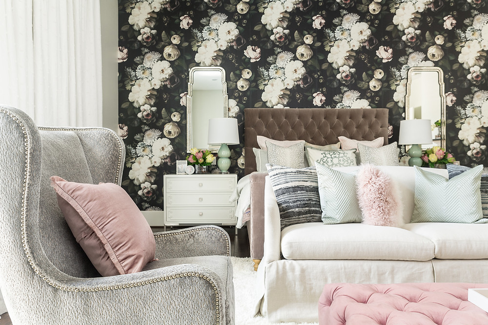 Master bedroom with bold floral wallpaper on feature wall.