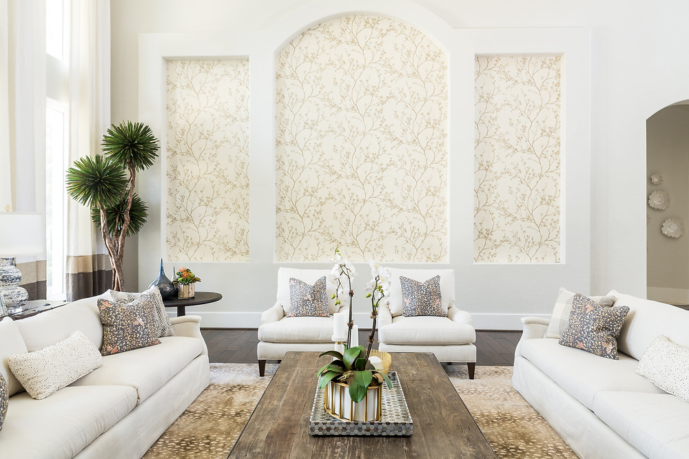 Living room with wallpaper in niche and white upholstery with antelope rug