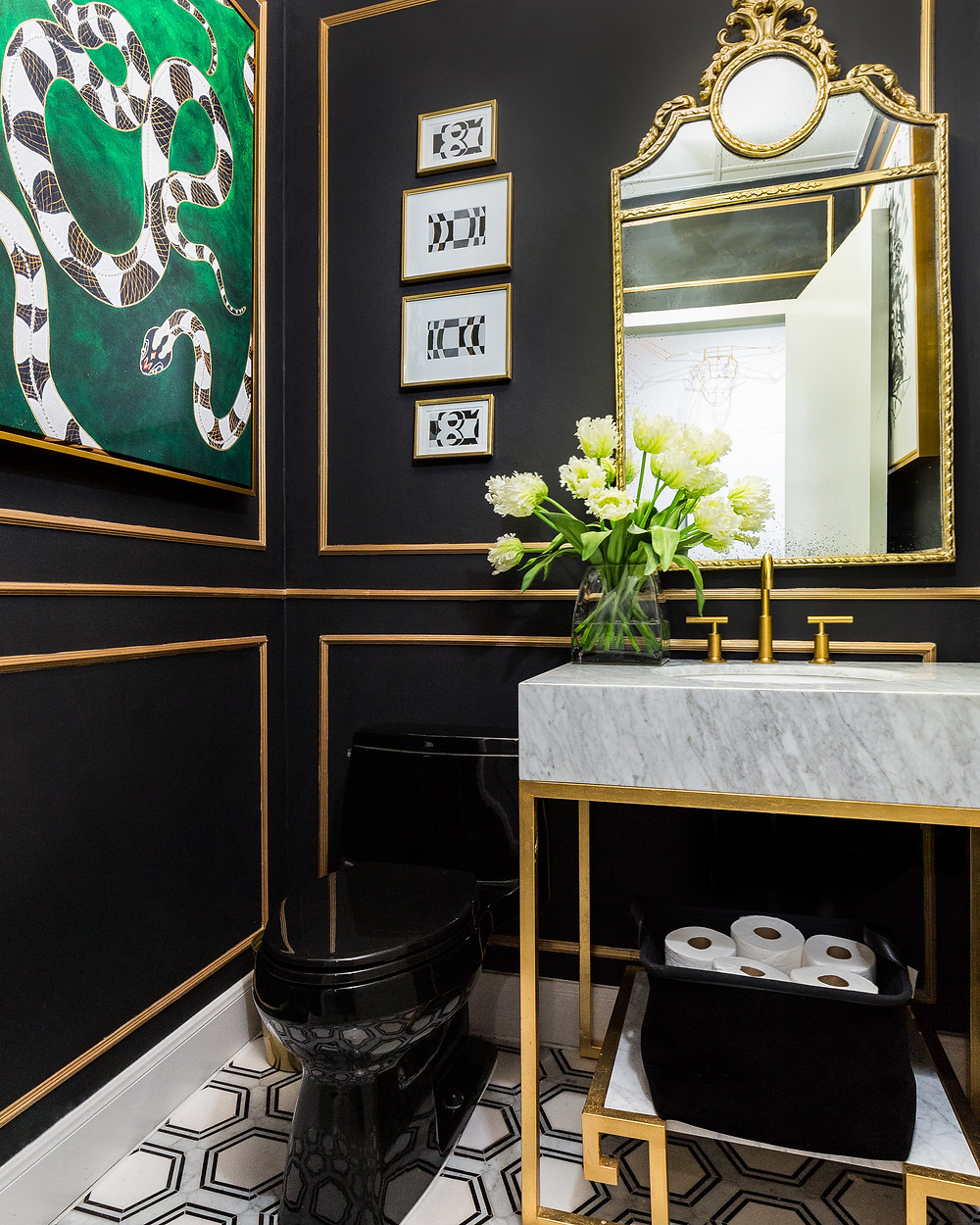 Black powder room with marble vanity