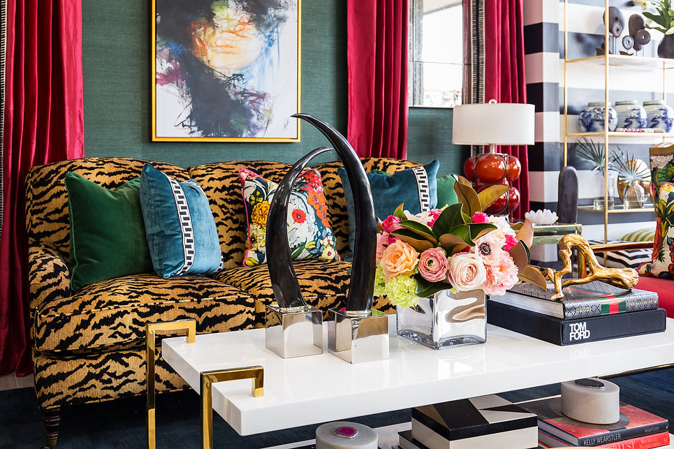 Bold and colorful living room with pink silk draperies