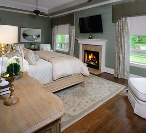 cozy bedroom with two sitting areas and fireplace