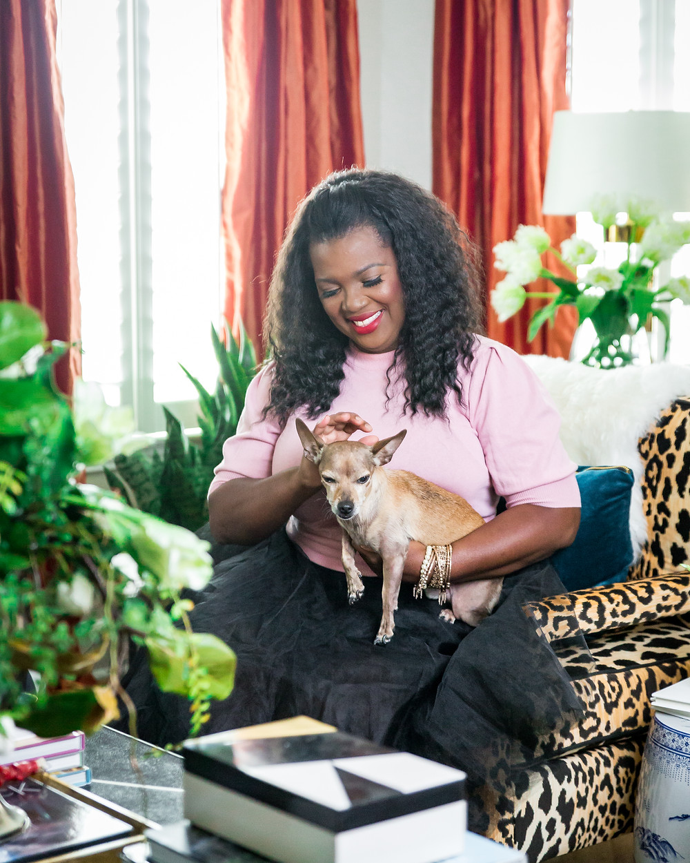 Veronica Solomon in her home with pet chiweenie