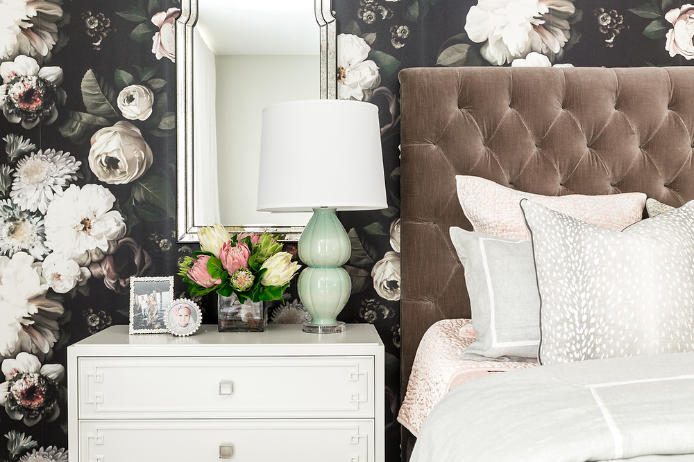 Bedroom with bold foral wallpaper