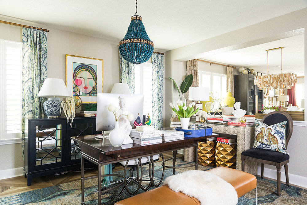 home office with blue wood bead chandelier