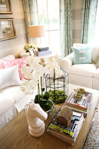 Modern farmhouse living room vignette with white slipcovered sofas