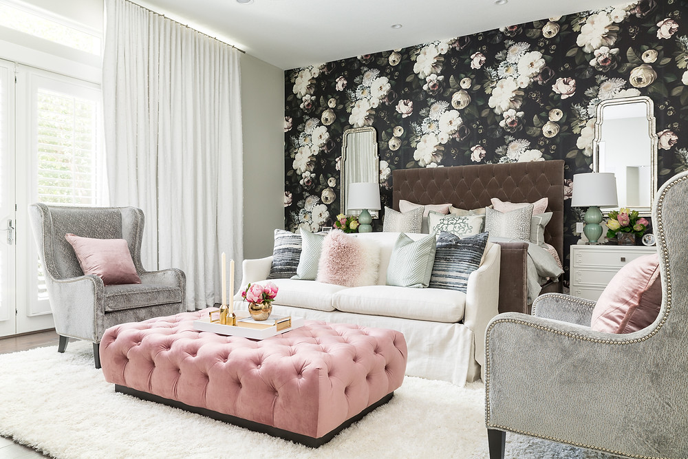 Romantic master bedroom with bold floral wallpaper
