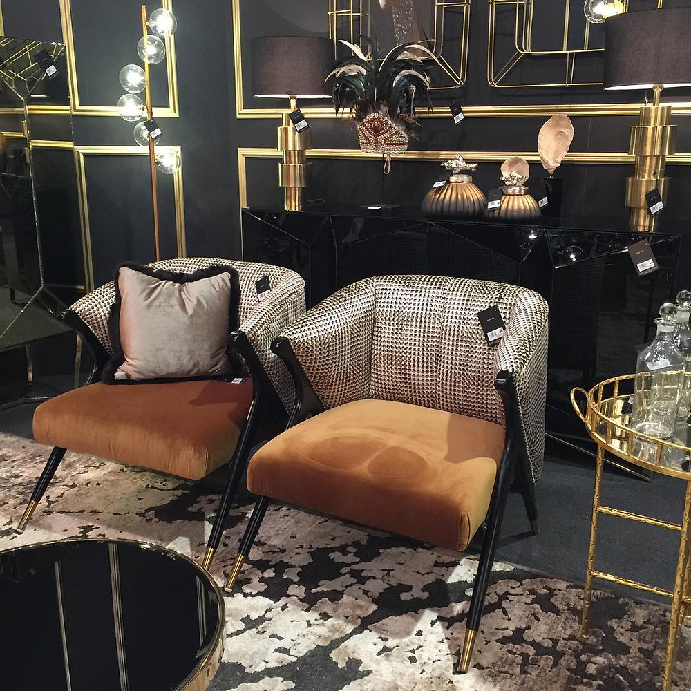 Maison and Objet, January 2019. Classic black and gold and men's suiting fabric on chairs