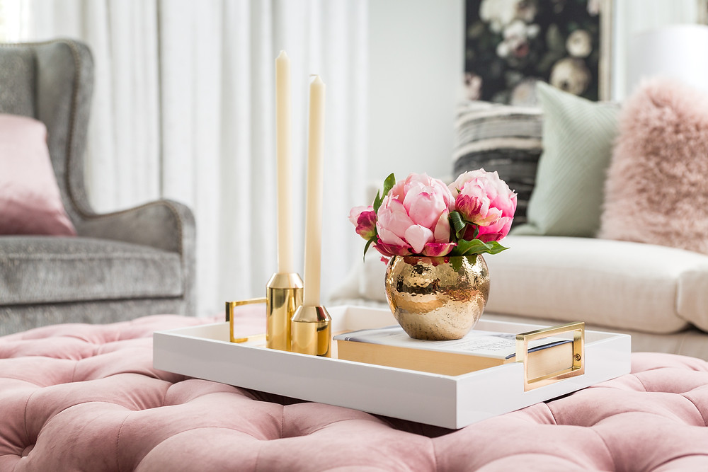 Tufted pink velvet ottoman style with tray and candles