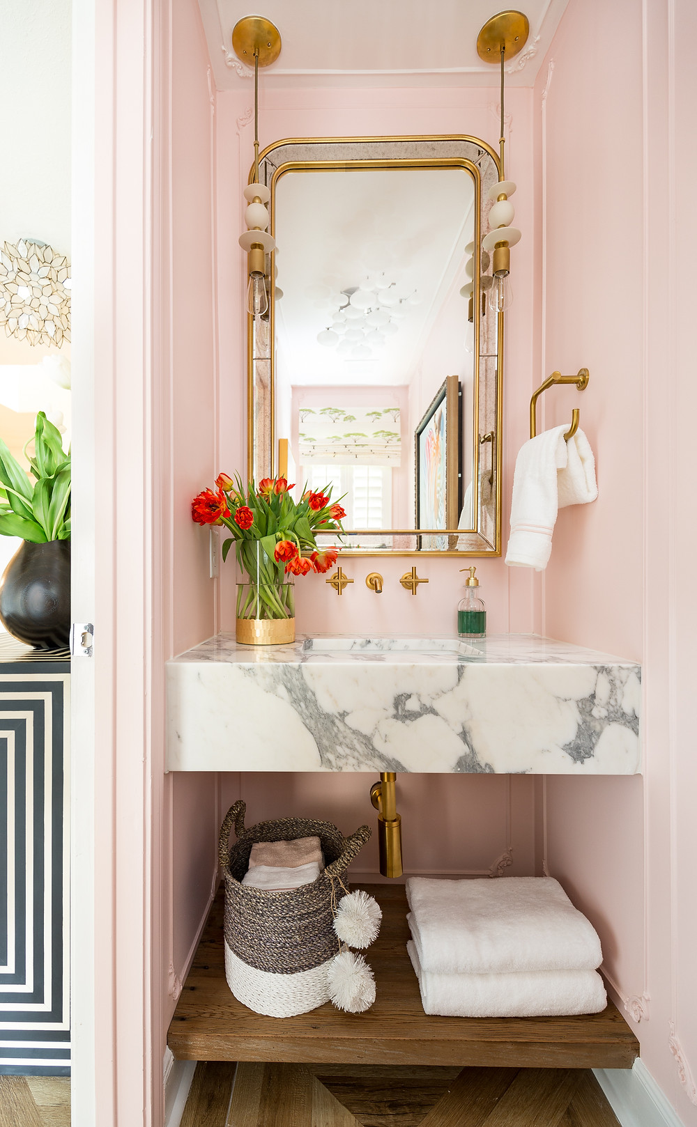 Powder room with blush walls