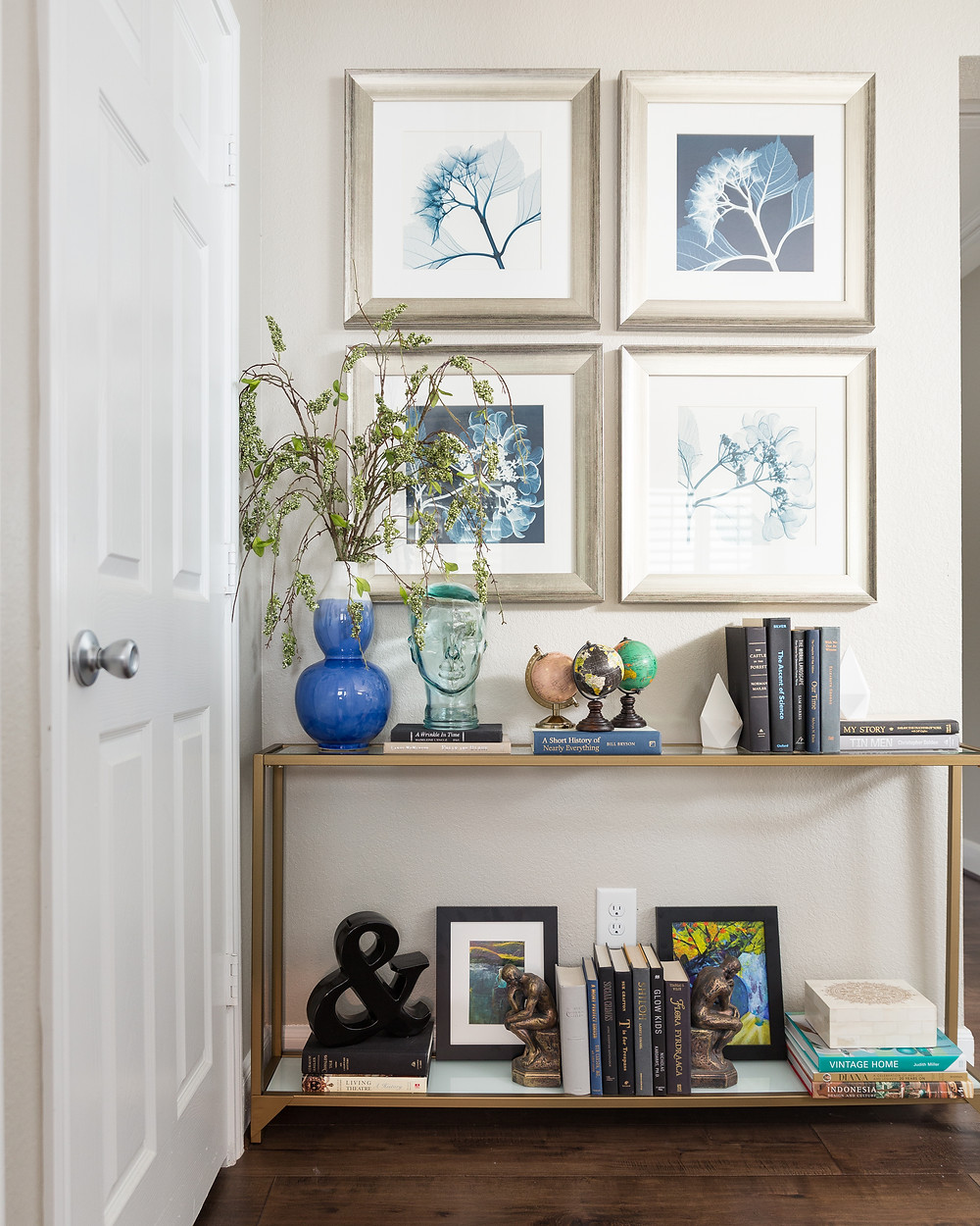 Narrow console table with leaf art