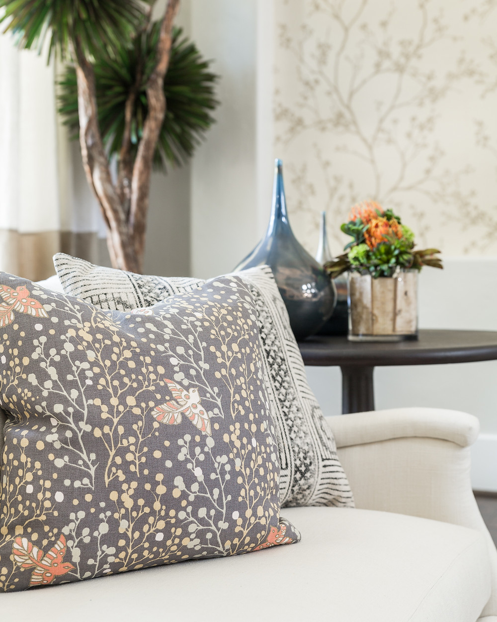 Living room with patterned pillows in a white slipcover look sofa