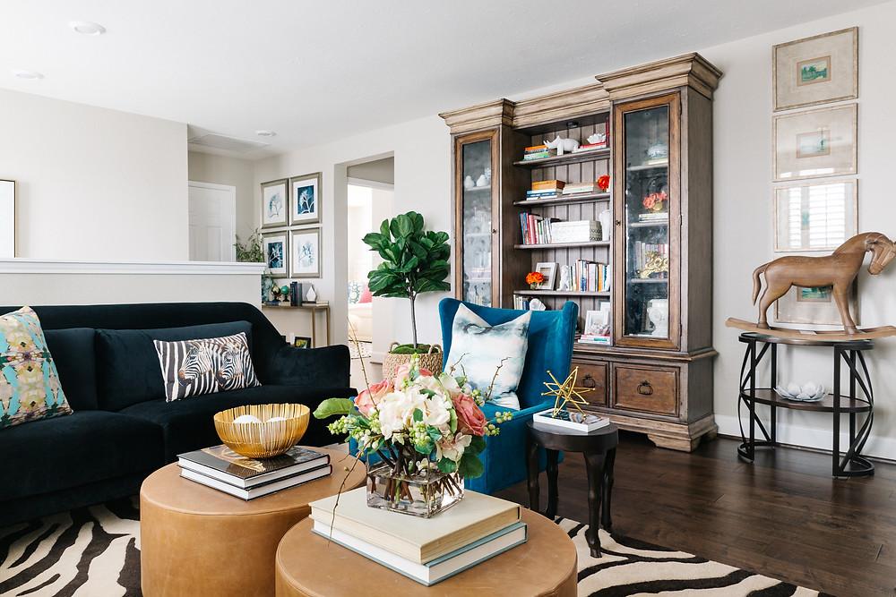 TV lounge with black velvet sofas and zebra rug