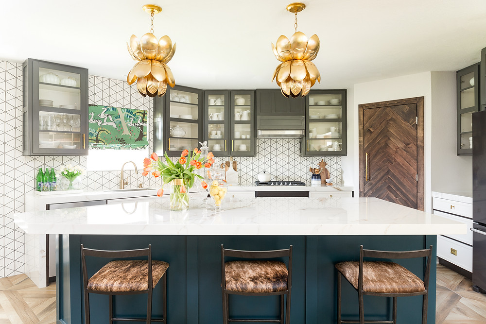 kitchen with gold pendants, herringbone rustic door, gray and white cabinets