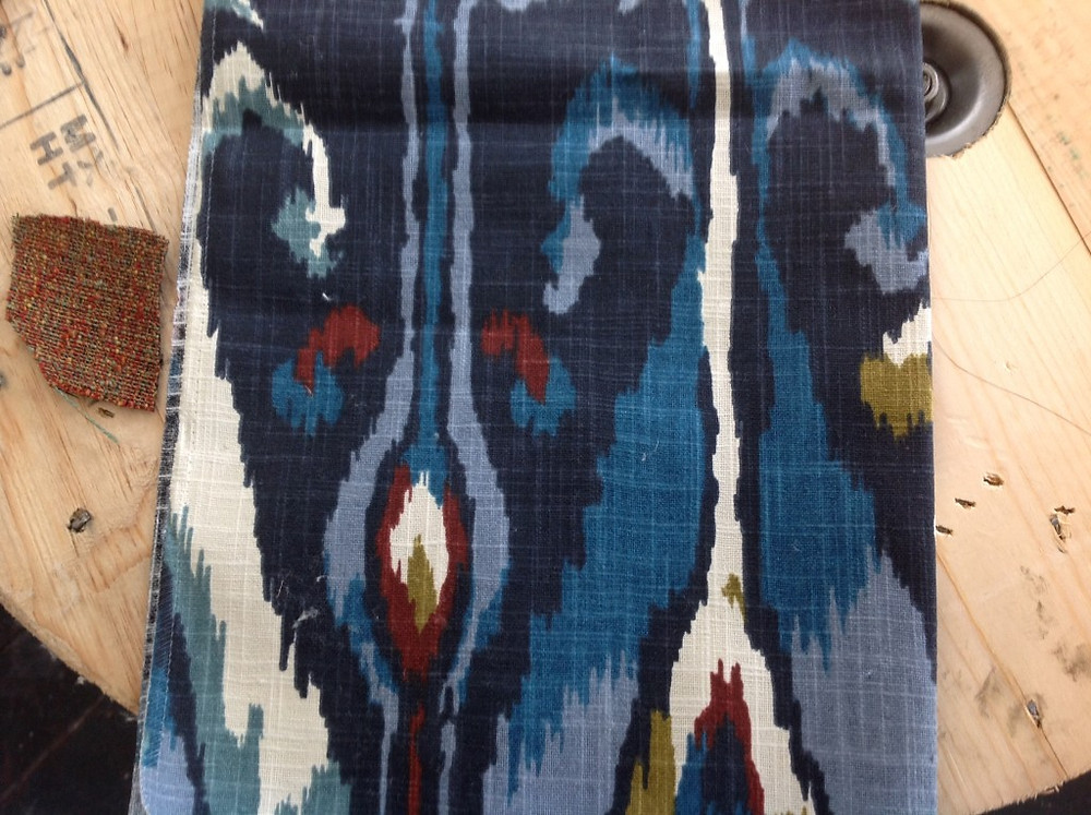 The Ikat fabric for the drapery and the textured linen is for the headboard
