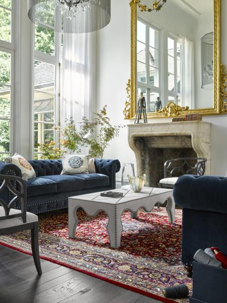 Universal Furniture living room with large gold mirror