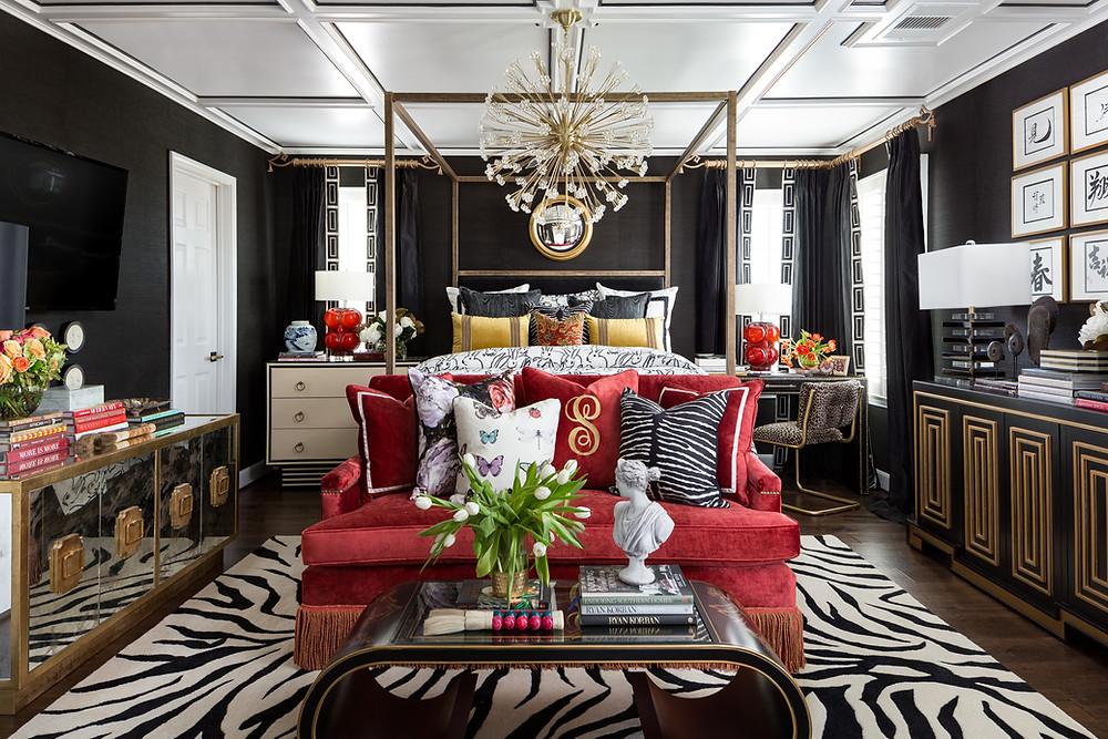 Black grascloth wallpaper, black silk drapery with trim, zebra rug, red velvet sofa with bullion fringe