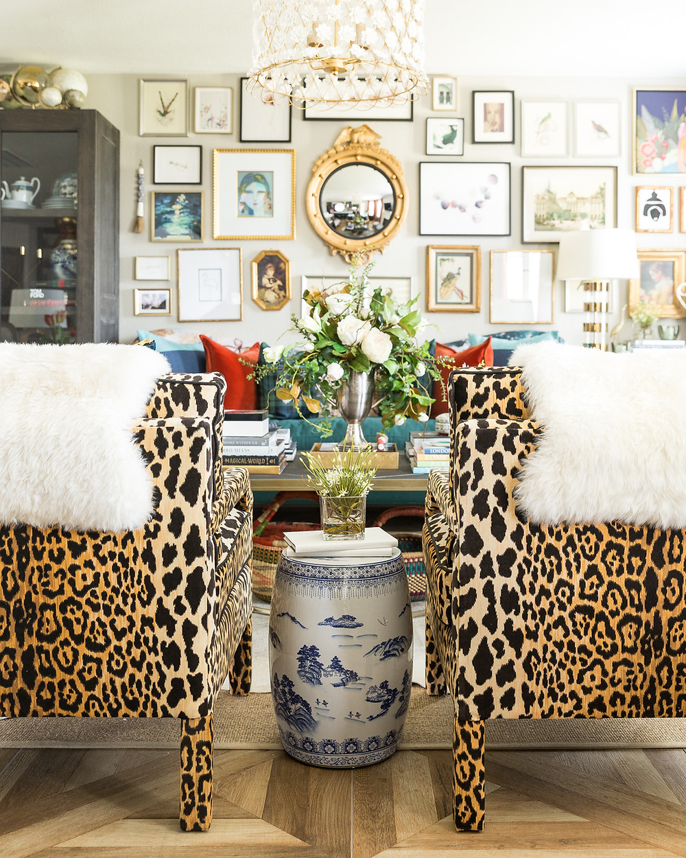 Maximalist living room with gallery wall and cheetah chairs