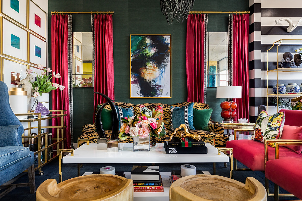 Bold living room with pattern and color mix anchored by a tiger sofa