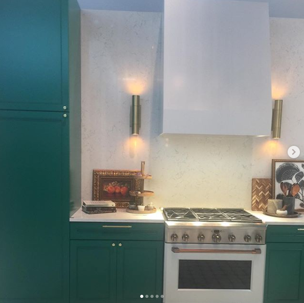 GE Appliances Booth At KBIS - Green Cabinetry With Matte White Cafe Appliances