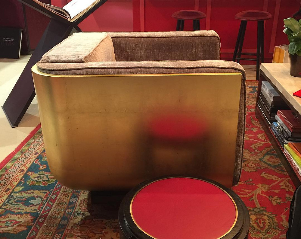 Brass back on upholstered chair