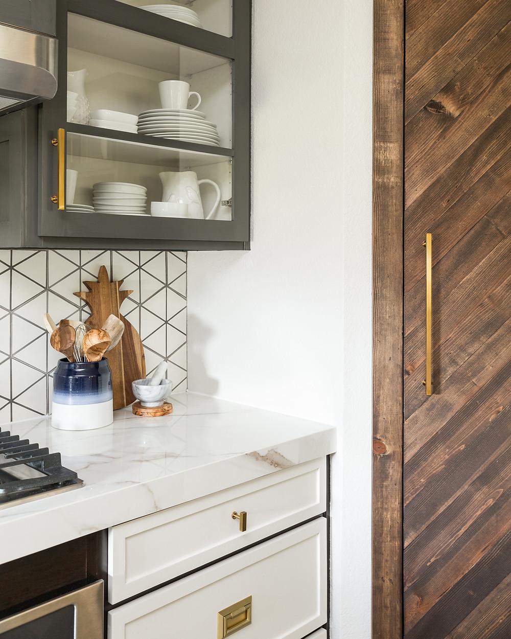 herringbone rustic pantry door in eclectic kitchen