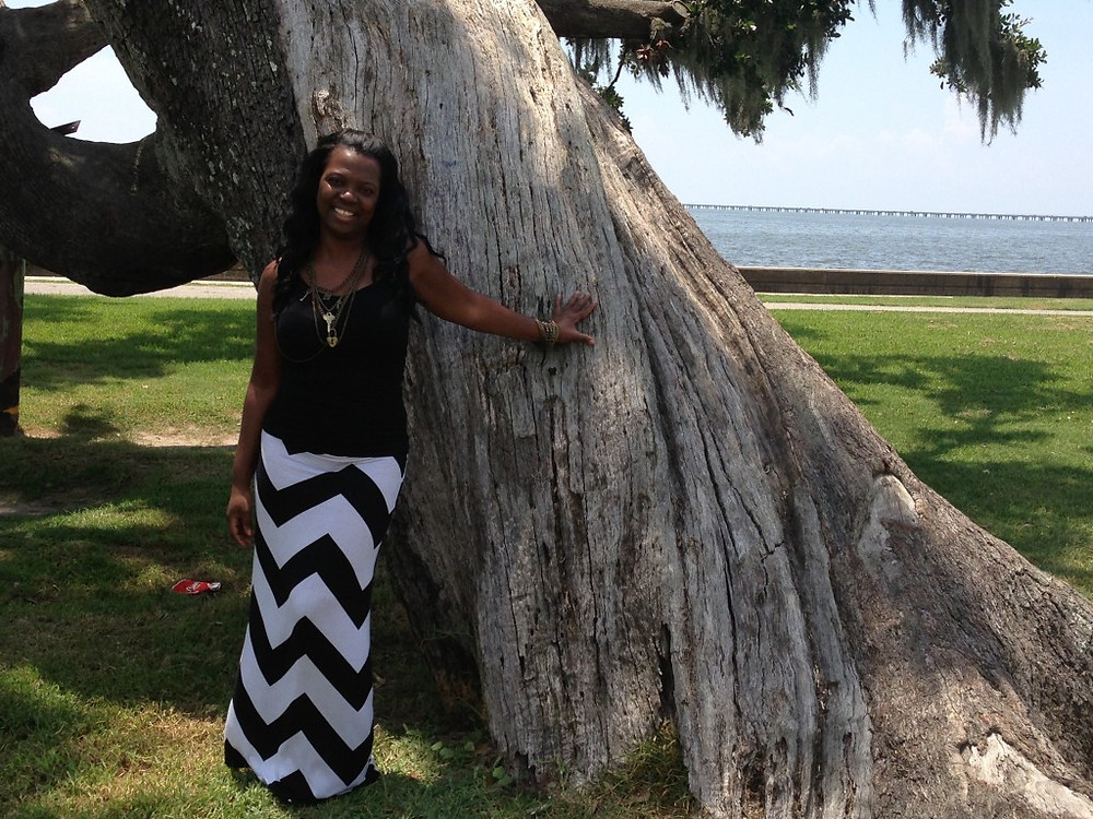 Here I am by Lake Pontchartrain, posing next to one of the really old oak trees, that clearly sustained damages from hurricane Katrina