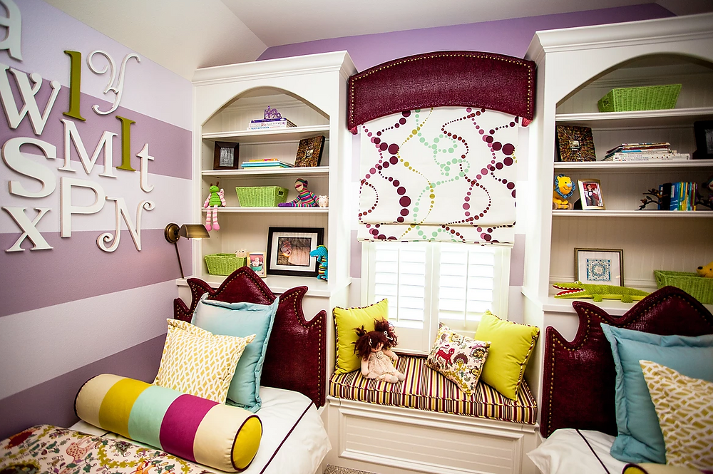 Shared bedroom for toddlers with built-in beds, bookcase and window seat