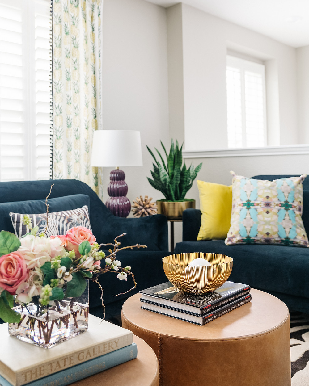 TV lounge with pineapple fabric on draperies