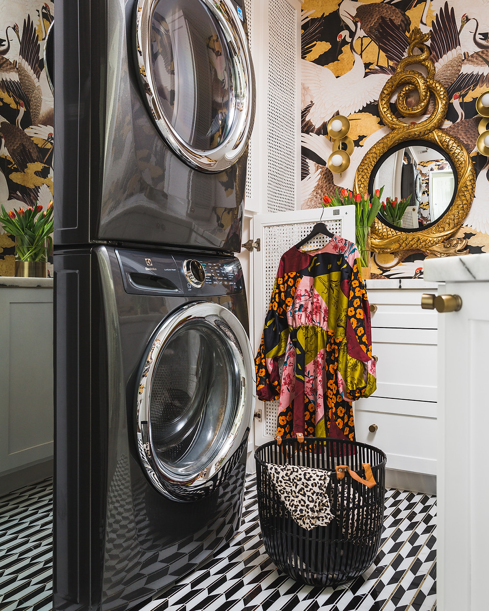 laundry Room With Black And White Marble Tile And LG Styler