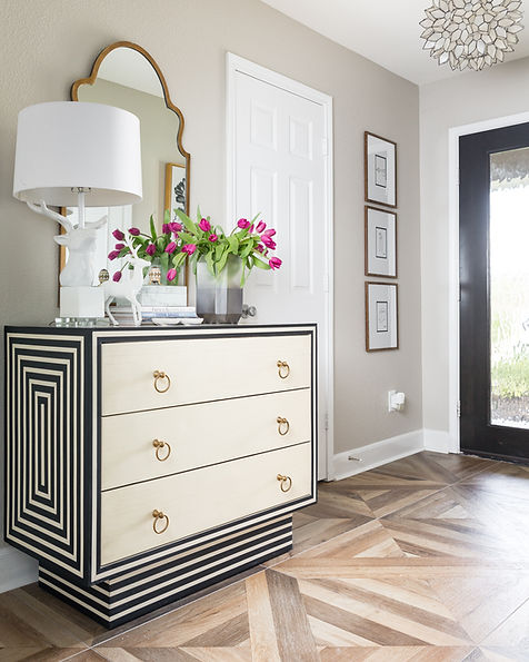 Foyer chest with black and white stripes