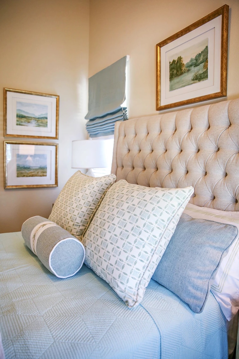 Guest bedroom with blues, greens and coral accents