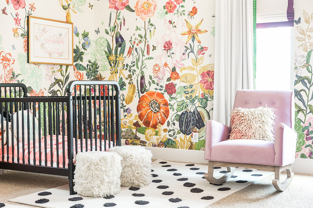 Toddler Bedroom with bold floral wallpaper and black crib