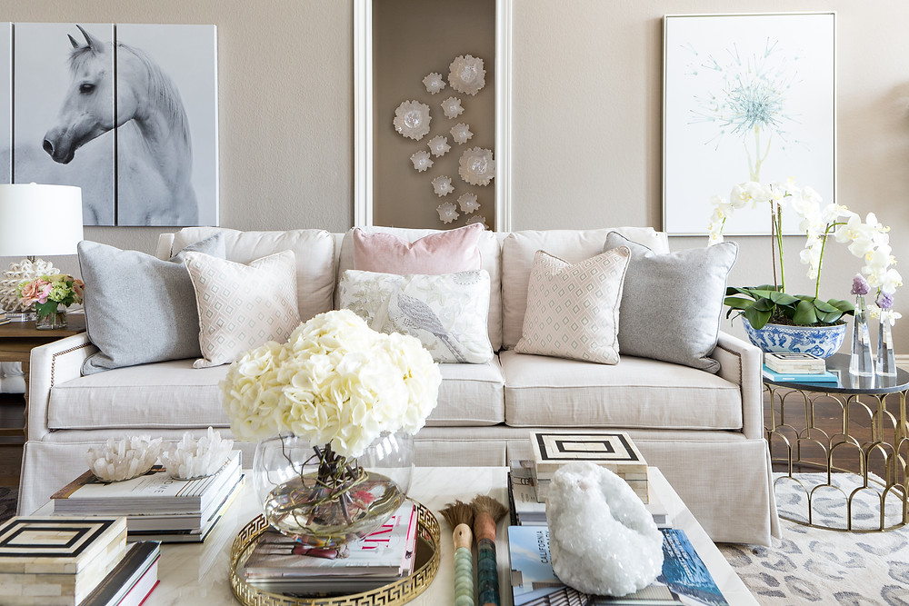 A white skirted sofa in this living room is covered in a performance fabric
