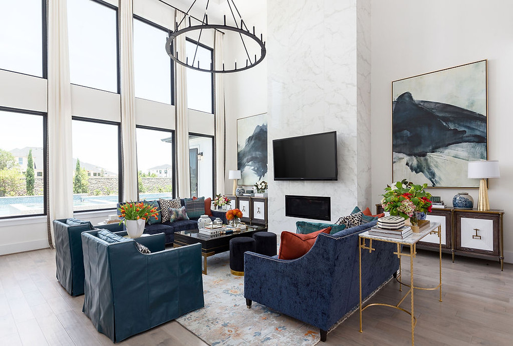 Navy sofas and teal leather chairs with skirt