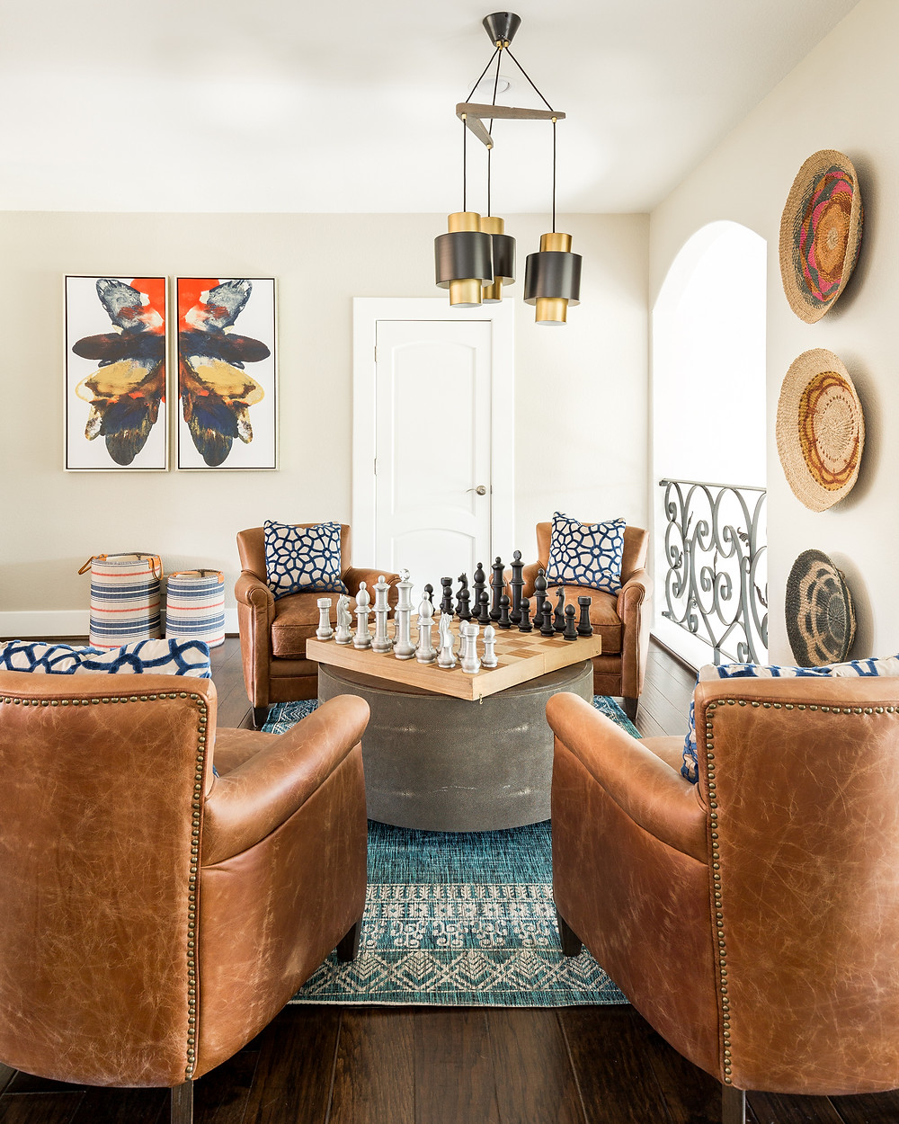 Leather chairs in a game room with African woven baskets