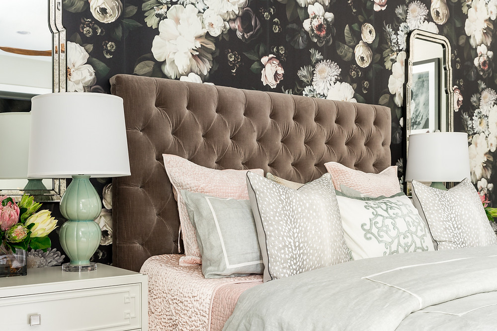Dark floral wallpaper by Ellie Cashman with upholstered headboard