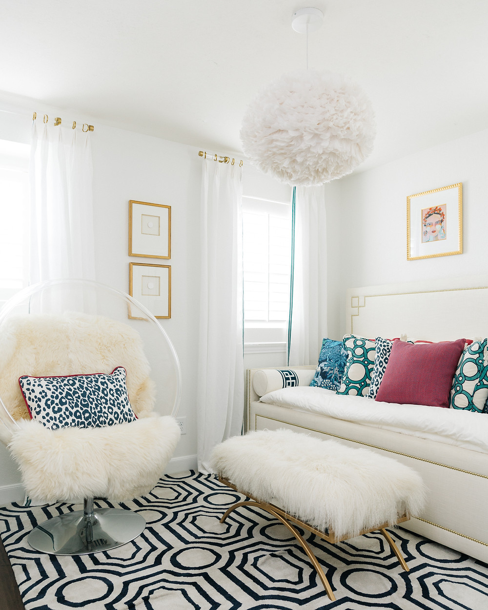 Guest bedroom with white walls and bold accents