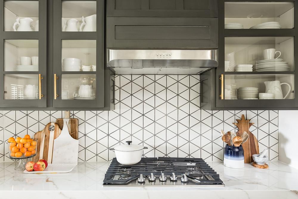 Kitchen vent hood and cement tile backsplash