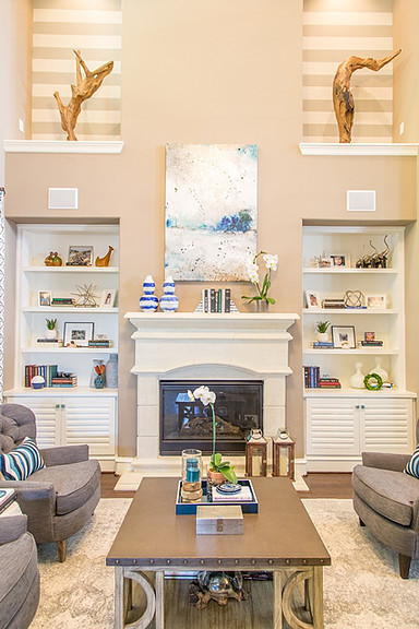 Blue and white living room, casual living room, pottery barn chairs, stripe walls, decorating a niche