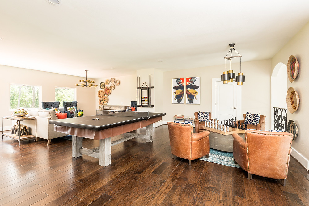 Game room with pool table and seating areas
