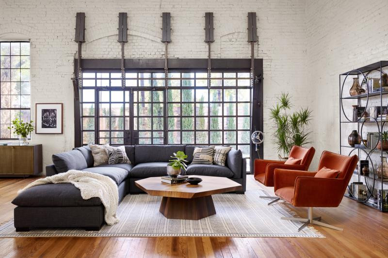Four Hands Living Room with sectional and orange chairs