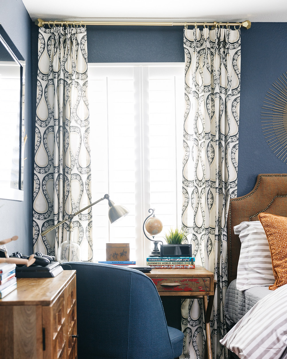 Boy's bedroom in hale navy wall color with custom draperies
