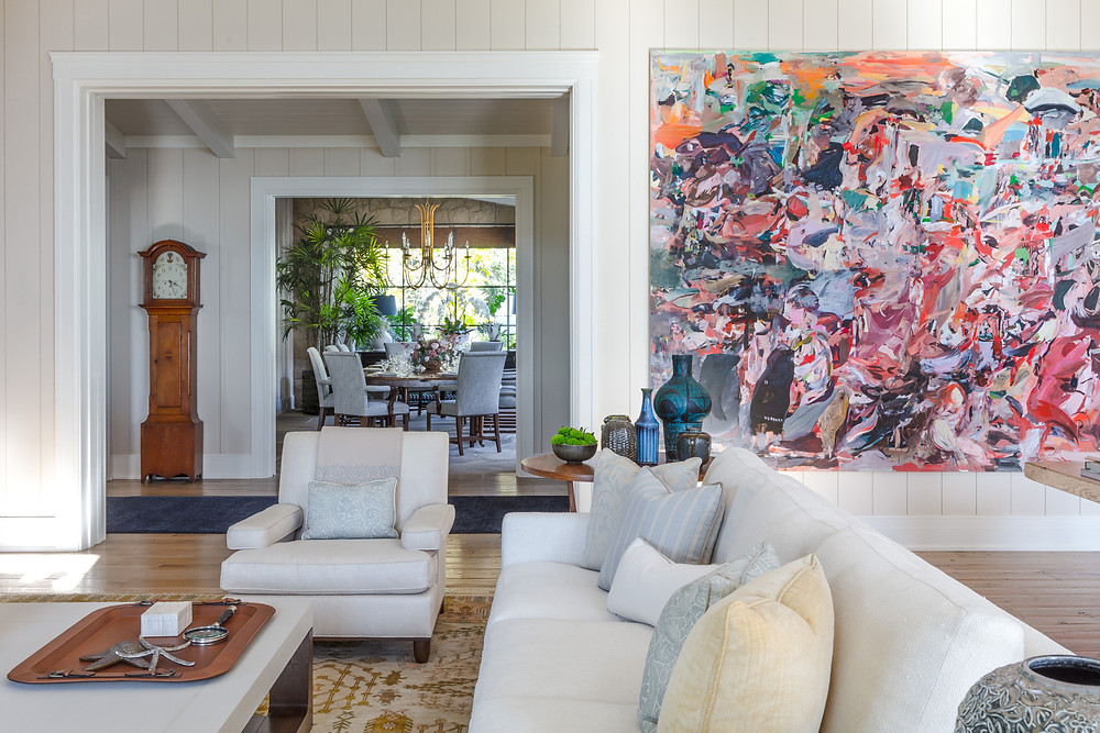 Bold art in a living room designed by Tom Stringer