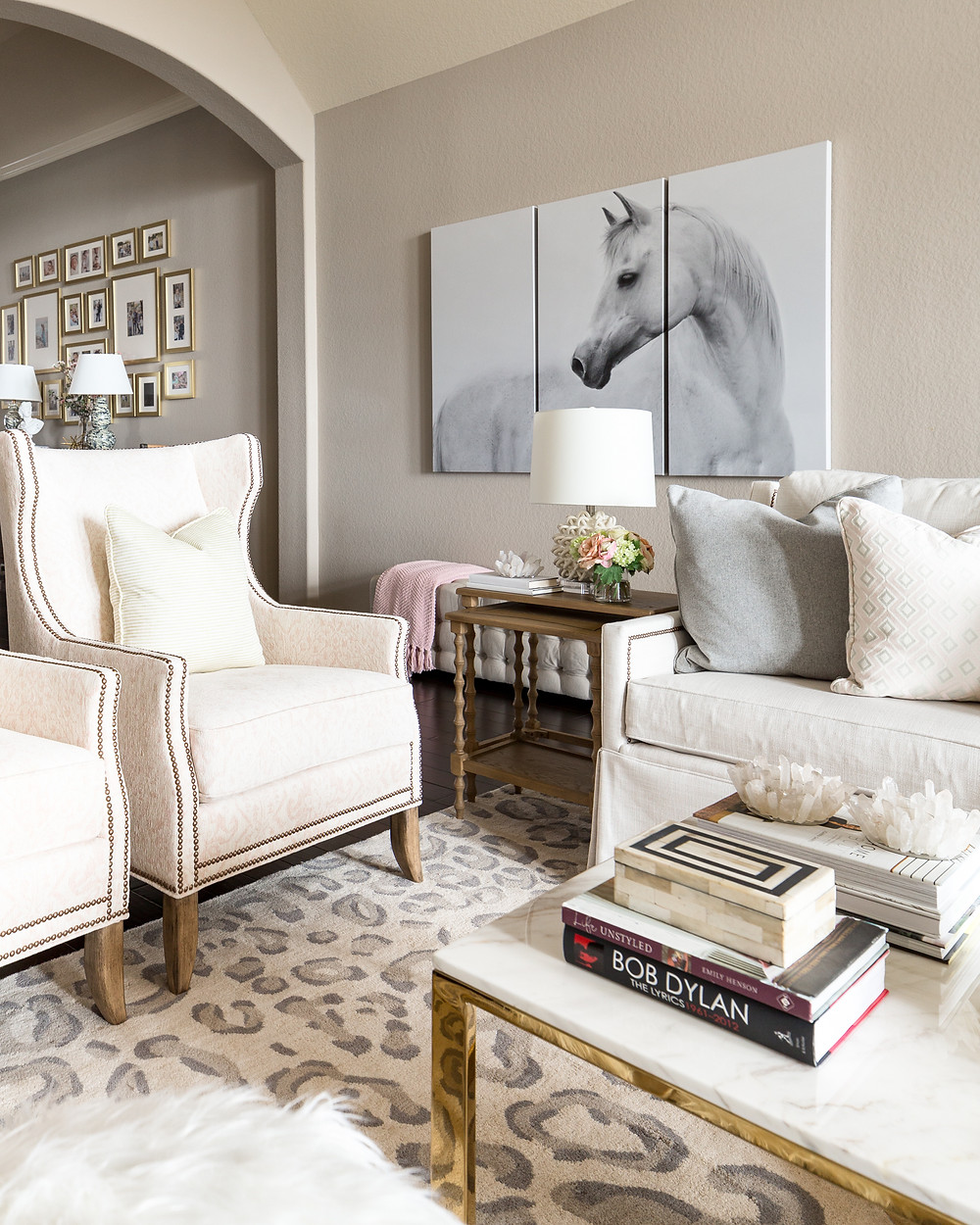 Living Room With Gallery Wall And Chairs In Blush Tones