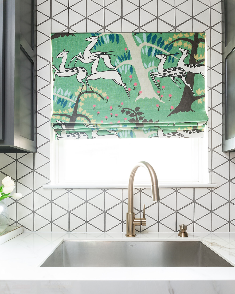 Roman shade in kitchen with cement tile backsplash