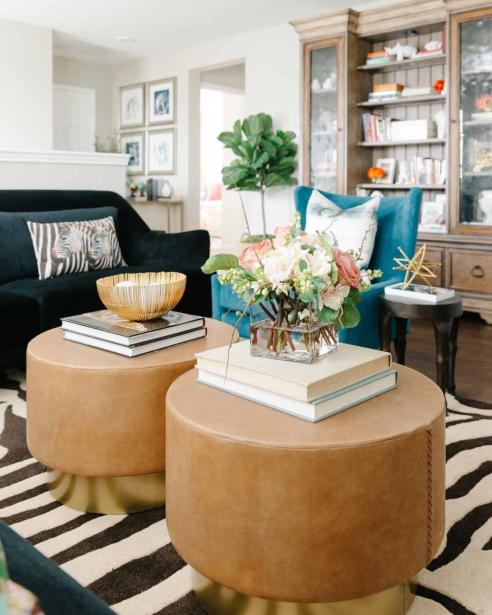 TV lounge with upholstered leather nesting coffee tables