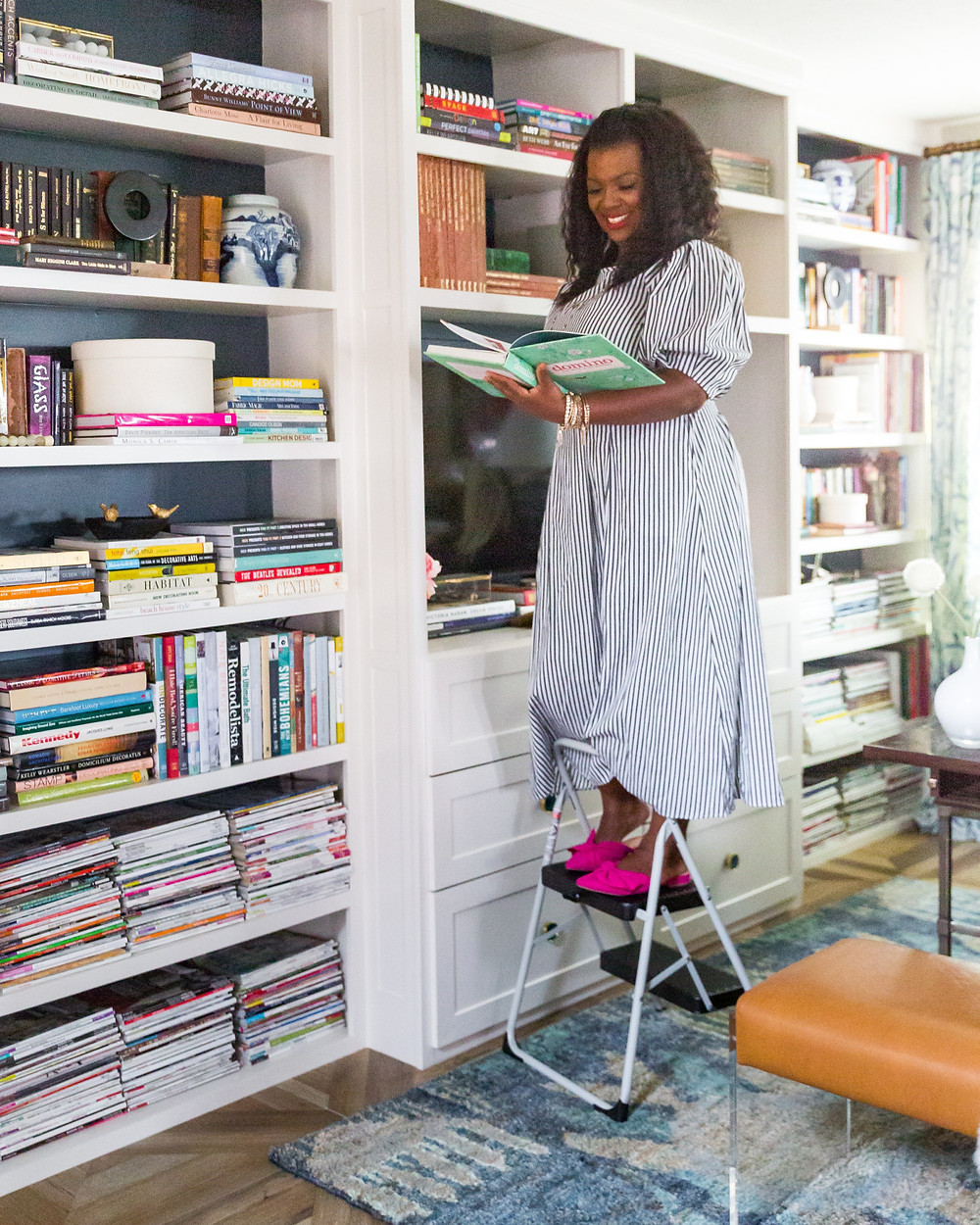 Veronica Solomon In her office with her book collection