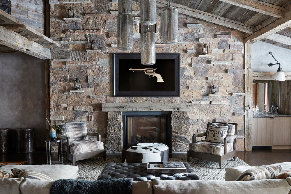 Cozy sitting room with stone fireplace and hand sawn beams