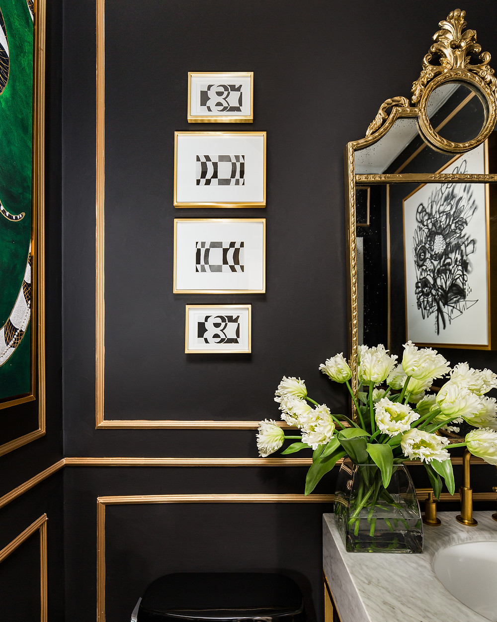 Powder room with black walls and gold accents